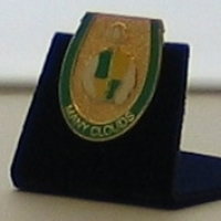 Many Clouds Badge